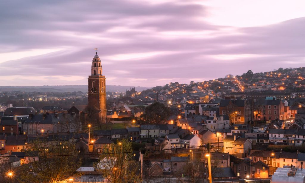 A city scape image of Cork City featuring the iconic landmark, Shandon Bells Tower.