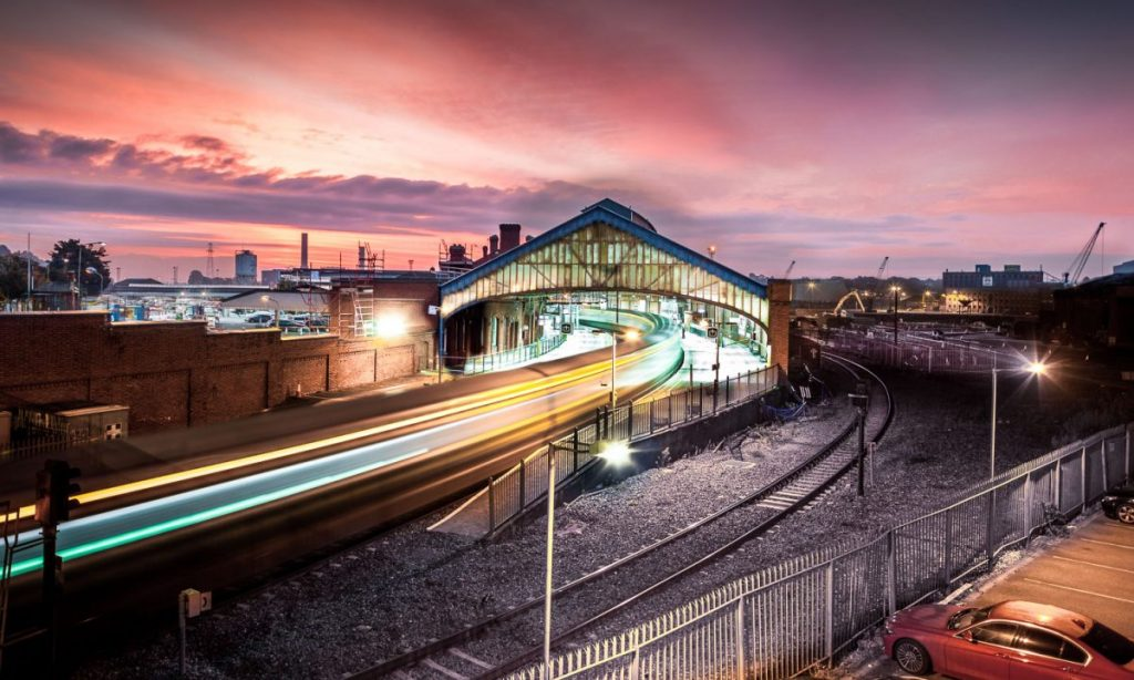 An Irish Rail train takes off at high speed from Cork's primary train station, Kent Station. Captured by photographer David Creedon.